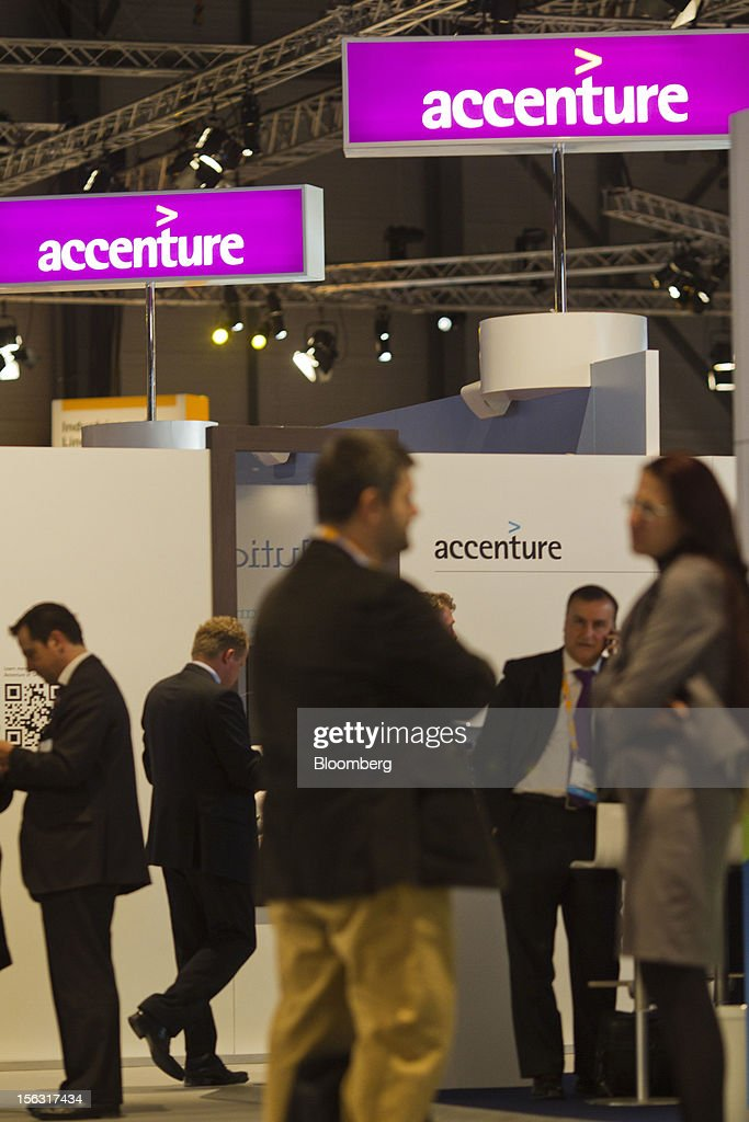 Visitors stand near the Accenture Plc pavilion on the opening day of the Sapphire Now and TechEd conference in Madrid, Spain, on Tuesday, Nov. 13, 2012. SAP plans to deliver 6 SAP mobile apps for Windows 8. Photographer: Angel Navarrete/Bloomberg via Getty Images