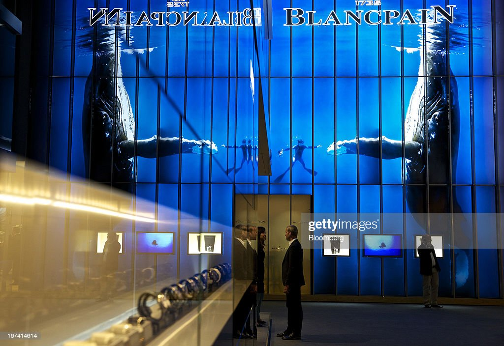 Visitors stand near the Blancpain booth, a luxury unit of Swatch Group AG, during the Baselworld watch fair in Basel, Switzerland, on Wednesday, April 24, 2013. The annual fair attracts 2,000 companies from the watch, jewelry and gem industries to show their new wares to more than 100,000 visitors. Photographer: Gianluca Colla/Bloomberg via Getty Images