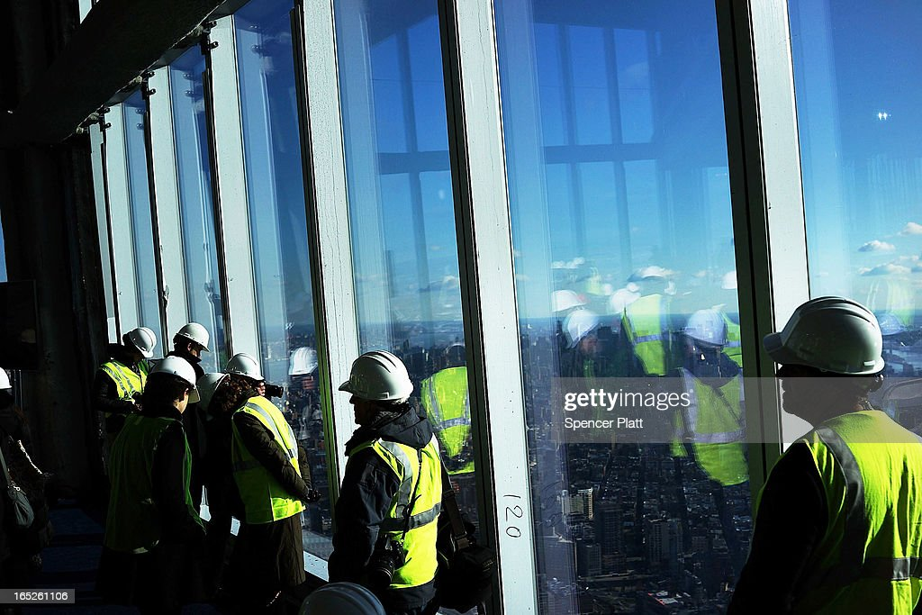 Visitors stand near the windows of the One World Observatory from the 100th floor of One World Trade Center at the Ground Zero site on April 2, 2013 in New York City. One World Observatory, which is situated more than 1,250 feet over lower Manhattan, will open to the public in 2015 and will include a pre-show theater, multiple spaces that allow for panoramas of the New York City region and numerous dining options. When completed, One World Trade Center will be the tallest building in the Western Hemisphere at 1776 feet.
