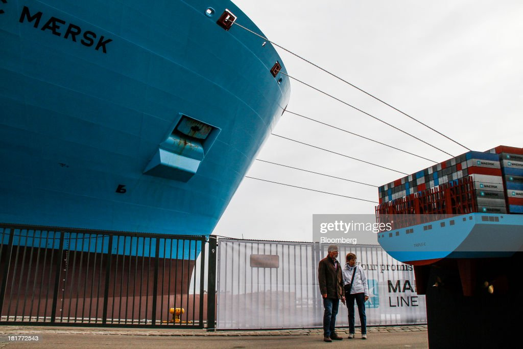 Visitors stand on the dockside and inspect a scale model during an open day for the Majestic Maersk Triple E class ship, one of the world's largest vessels, operated by A.P. Moeller-Maersk A/S at Langelinie pier in Copenhagen, Denmark, on Tuesday, Sept. 24, 2013. A.P. Moeller-Maersk A/S says it won't cut its investment in developing markets from Asia to South America even as creditors turn their backs. Photographer: Freya Ingrid Morales/Bloomberg via Getty Images
