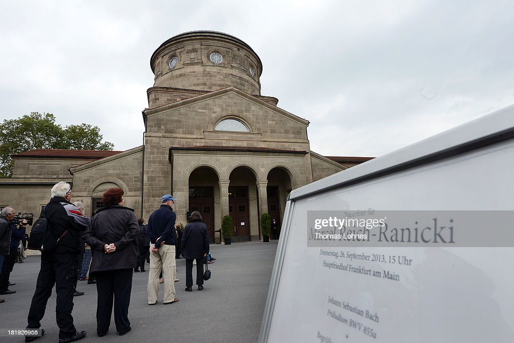 Visitors stand outside during the funeral service for the literary critic Marcel Reich-Ranicki (1920 - 2013) in front of the mourning hall on September 26, 2013 in Frankfurt am Main, Germany.