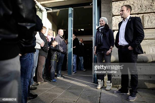 Visitors stand outside the special exhibition 'ROBERT gedENKEn' at State Museum and listen to a speech by Teresa Enke wife of Robert Enke on November...