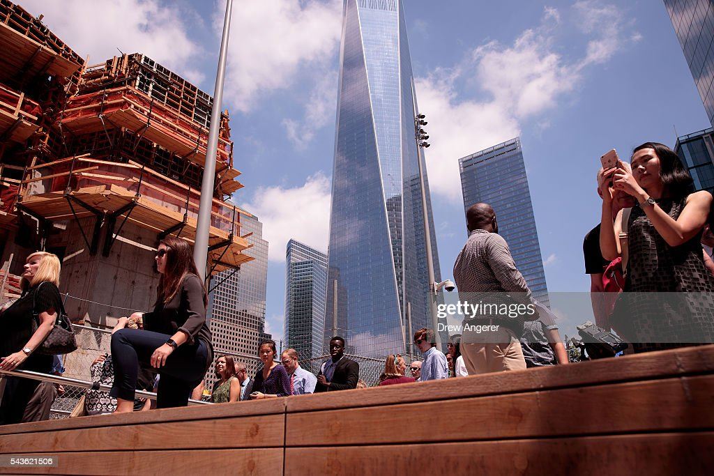 Visitors stream into Liberty Park as it opens to the public for the first time, June 29, 2016 in New York City. Liberty Park, elevated above Liberty Street in Lower Manhattan, overlooks the National September 11 Memorial Plaza and One World Trade Center. The one-acre, $50 million park will be open to the public every day from 6 in the morning to 11 at night.