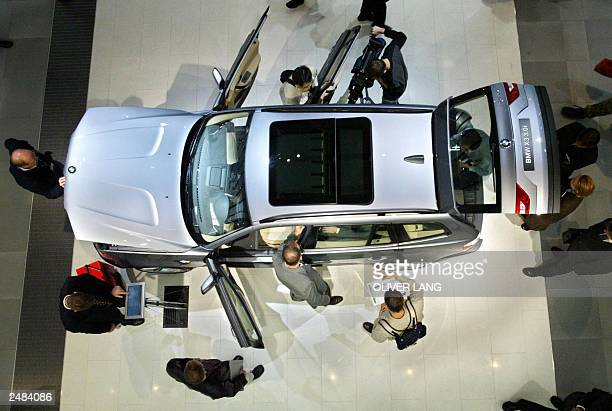 Visitors surround a new BMW X3 30 displayed at Frankfurt's Internationale AutomobilAusstellung 09 September 2003 during the media opening of the 60th...