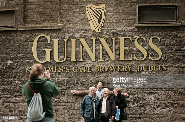 Visitors take a photograph at the Guinness brewery on April 16 2006 in Dublin Ireland