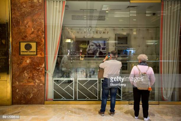 Visitors take a photograph of the Ivanka Trump Collection store at Trump Tower in New York US on Thursday June 1 2017 Two Chinese labor activists...