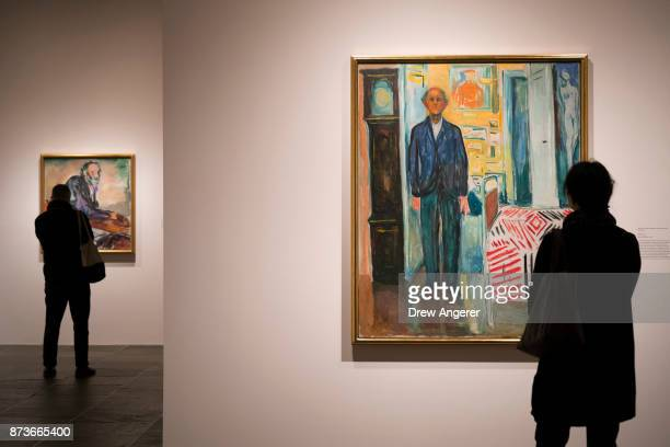 Visitors take in the selfportrait section of the Edward Munch exhibition titled 'Between The Clock and The Bed' at the Met Breuer November 13 2017 in...