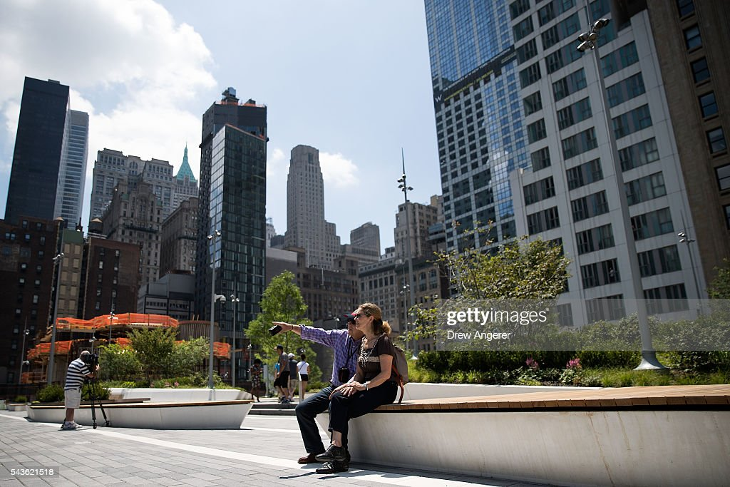 Visitors take in the view at the newly opened Liberty Park in Lower Manhattan, June 29, 2016 in New York City. Liberty Park, elevated above Liberty Street in Lower Manhattan, overlooks the National September 11 Memorial Plaza and One World Trade Center. The one-acre, $50 million park will be open to the public every day from 6 in the morning to 11 at night.