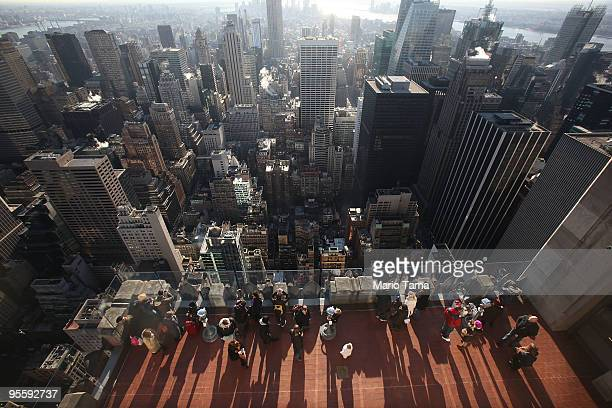 Visitors take in the view at Top of the Rock Observation Deck at 30 Rockefeller Plaza January 5 2010 in New York City New York City overtook Orlando...