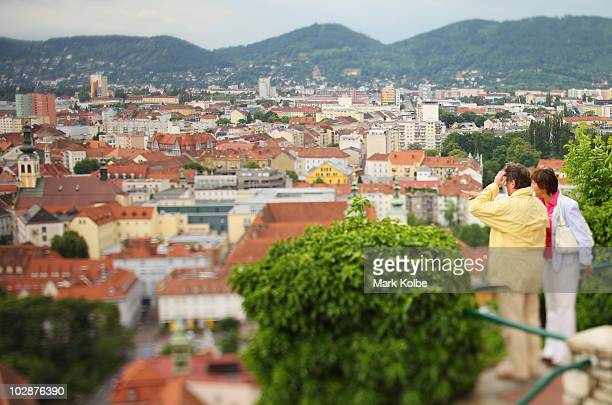 Visitors take in the views from a lookout on the Schlossberg on May 29 2010 in Graz Austria The Schlossberg in the centre of the city of Graz is a...