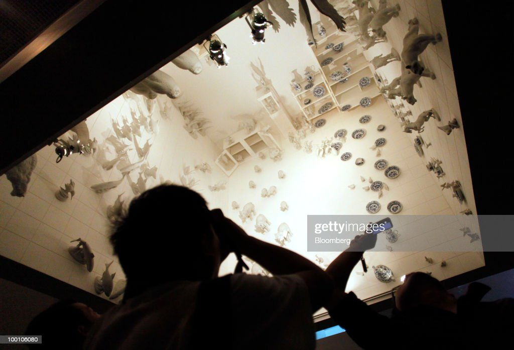 Visitors take photos of an installation in the Czech Pavilion at the 2010 World Expo site in Shanghai, China, on Thursday, May 20, 2010. The 2010 World Expo will take place until October 31. Photographer: Qilai Shen/Bloomberg via Getty Images