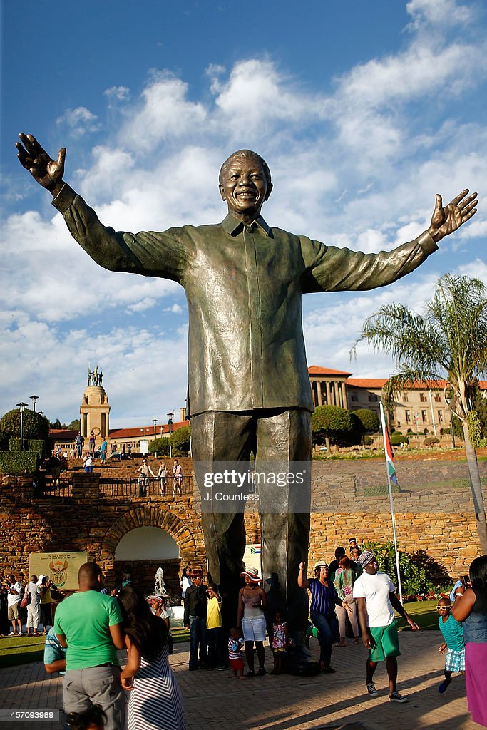 Visitors take photos of the statue of Former South African President Nelson Mandela that was unveiled at the Union Buildings on December 16, 2013 in Pretoria, South Africa. The statue was dedicated on the day after the burial of Nelson Mandela in his home village of Qunu on December 15, 2013. Nelson Mandela passed away on the evening of December 5, 2013 at his home in Houghton at the age of 95. Mandela became South Africa's first black president in 1994 after spending 27 years in jail for his activism against apartheid in a racially-divided South Africa. December 16 is celebrated in South Africa as Reconciliation Day and marks several significant events in South African history.