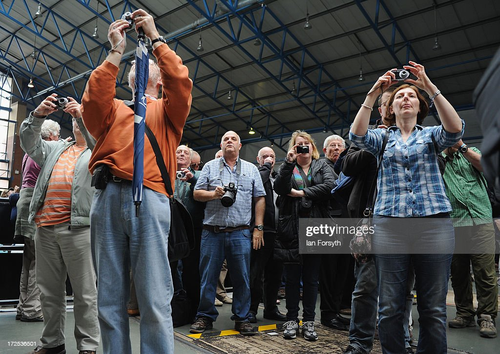 Visitors take pictures during an event at the National Railway Museum on July 3, 2013 in York, England. The National Railway Museum's 'Great Gathering' marks 75 years since the world's fastest steam locomotive, Mallard, made its world record breaking run in 1938, and reunites the locomotive with its five sister locomotives, the Sir Nigel Gresley, Dwight D Eisenhower, Union of South Africa, Bittern, Mallard and the Dominion of Canada