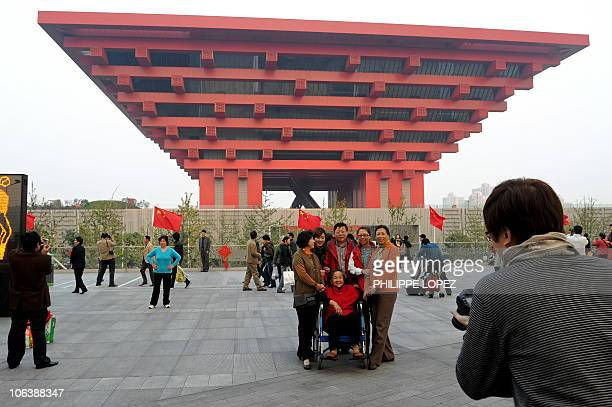 Visitors take pictures in front of the Chinese pavilion at the site of the World Expo 2010 in Shanghai on October 31 2010 Shanghai on October 31...