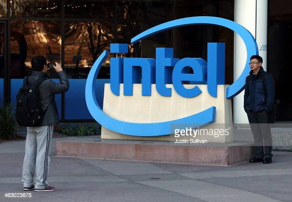 Visitors take pictures next to the Intel logo outside of the Intel headquarters on January 16 2014 in Santa Clara California Intel will report fourth...
