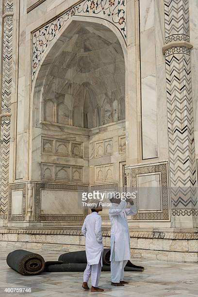 Visitors take pictures of a Taj Mahal wall The Taj Mahal is a white marble mausoleum built by Mughal emperor Shah Jahan in memory of his third wife...