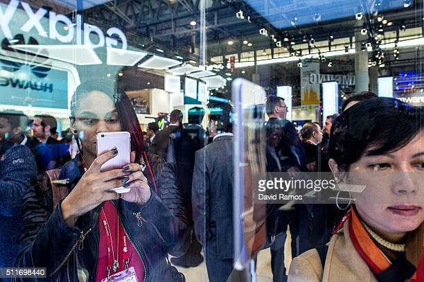Visitors take pictures of the new Samsung Galaxy S7 on the opening day of the World Mobile Congress at the Fira Gran Via Complex on February 22 2016...