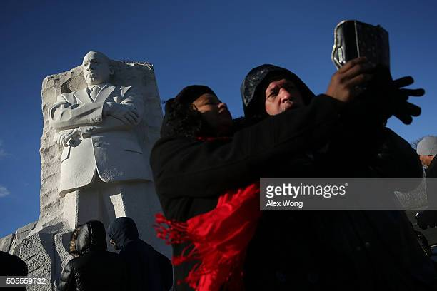 Visitors take selfies at Martin Luther King Jr Memorial January 18 2016 in Washington DC The nation observes the life and legacy of Martin Luther...
