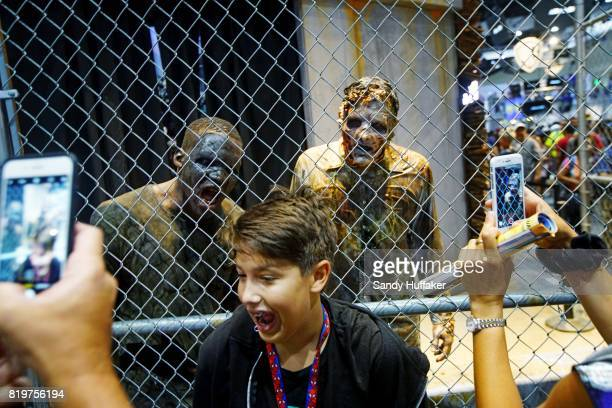 Visitors take selfies at The Walking Dead booth at Comic Con International on July 20 2017 in San Diego California Comic Con International is North...