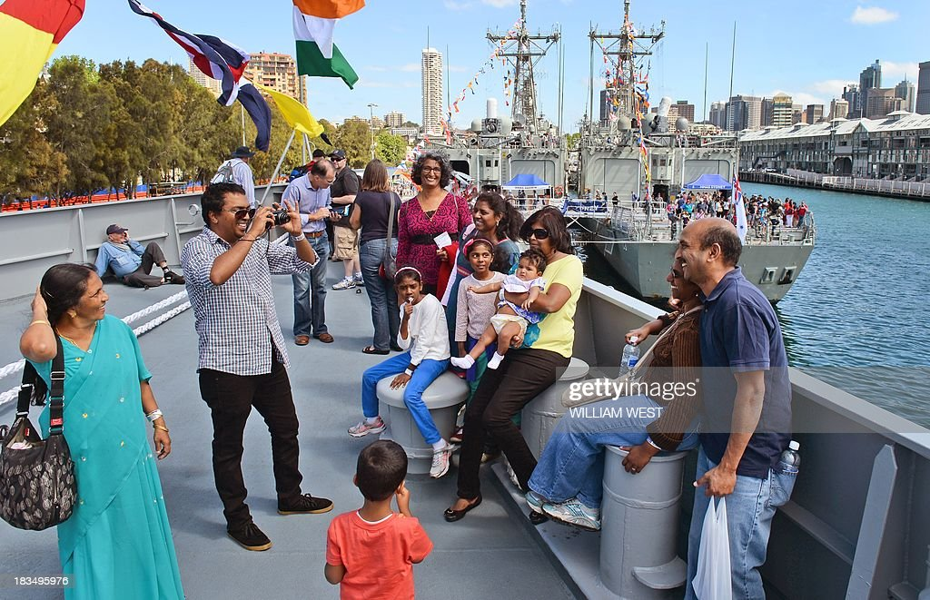 Visitors take their photo on the bow of the Indian warship INS Sahyadri at Royal Australian Navy's Sydney base of Garden Island, during an open day after the Australian Navy celebrated 100 years since their first ships entered Sydney Harbour, on October 7, 2013. The open day followed the Royal Australian Navy International Fleet Review which also included visiting warships from Britain, Singapore, Japan, India, Thailand and the United States. AFP PHOTO/William WEST