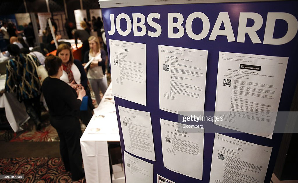 Visitors talk with recruiters during a jobs fair in Reading UK on Friday June 6 2014 Britain's unemployment rate fell to a fiveyear low in the first...