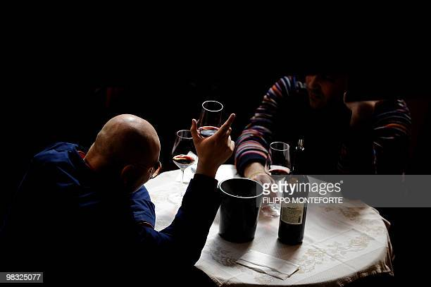 Visitors taste red wine on the first day of the 44th Vinitaly wine fair in Verona on April 8 2010 150000 visitors are expected to attend the Vinitaly...