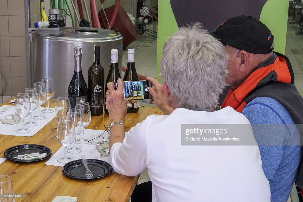 Visitors taste some Prosecco at the winery on September 11, 2017 in Treviso, Italy. According to Coldiretti, the Italian agricultural lobby, British buyers drank 40 million liters of Prosecco in 2016 and spent more than 350 million euros on it, representing approximately 30% market growth for the year.