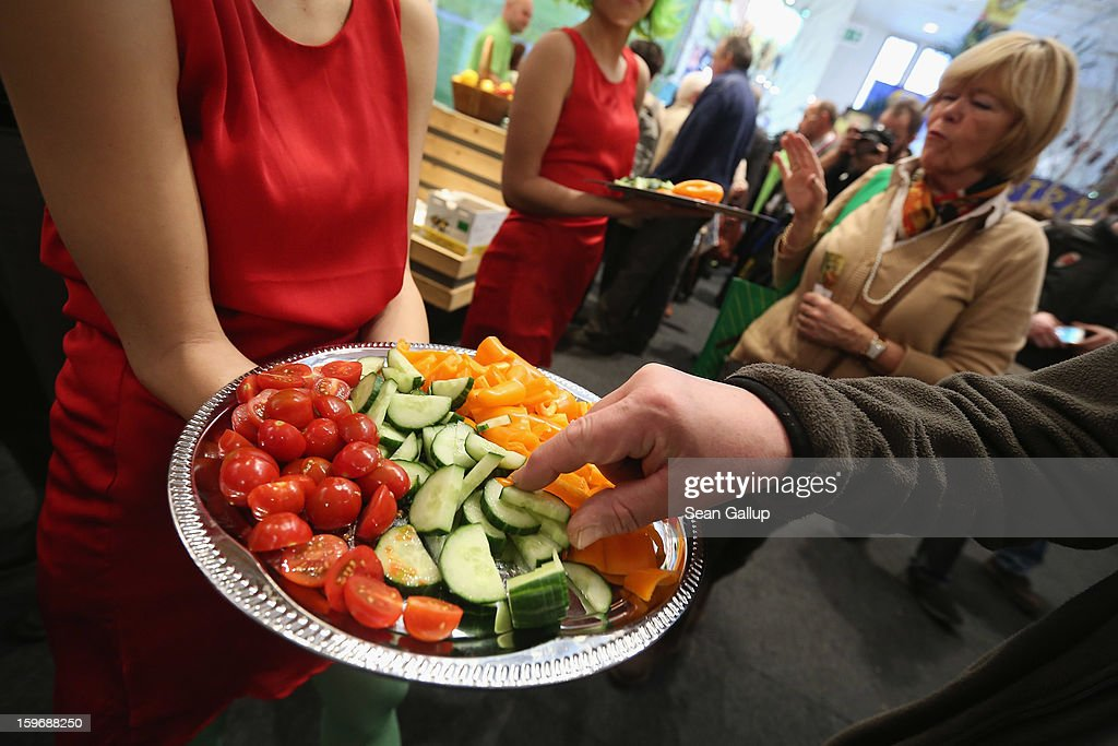 Visitors taste vegetables from Holland, including cucumber, tomatoes, and paprikas at the 2013 Gruene Woche agricultural trade fair on January 18, 2013 in Berlin, Germany. The Gruene Woche, which is the world's largest agricultural trade fair, runs from January 18-27, and this year's partner country is Holland. According to a recent study the average German consumes 1094 animals in his or her lifetime, including four cows, four sheep, 12 geese, 37 ducks, 46 turkeys, 46 pigs and 945 chickens.