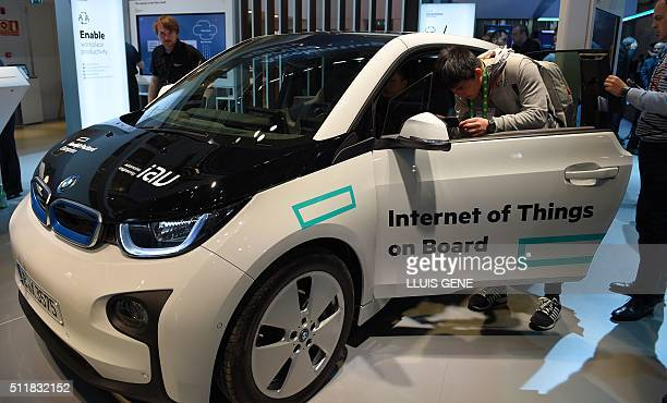 Visitors test a car with internet conection during on the second day of the Mobile World Congress in Barcelona on February 23 2016 The world's...