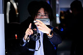 Visitors test an HTC M9 smartphone device during an HTC Corp news conference ahead of the Mobile World Congress 2015 in Barcelona Spain on Sunday...