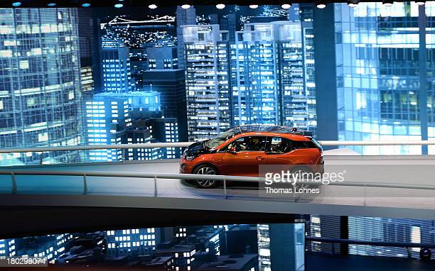 Visitors test drive the first fully electric car the BMW i3 from the car maker BMW at the IAA international automobile show on September 11 2013 in...