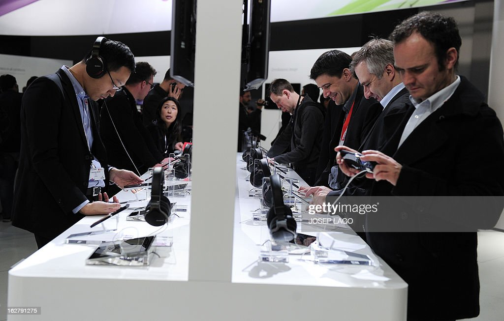 Visitors test new products by Sony at the mobile world congress in Barcelona on February 27, 2013 on the third day of the Mobile World Congress. The 2013 Mobile World Congress, the world's biggest mobile fair, is held from February 25 to 28 in Barcelona.