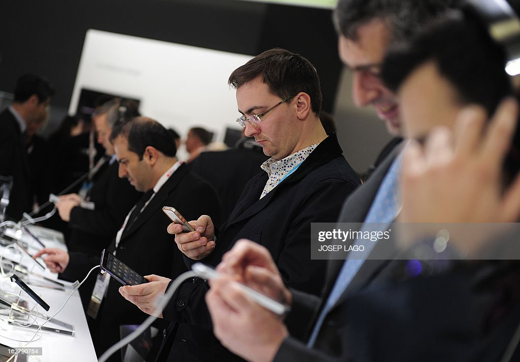 Visitors test new products by Sony on February 27, 2013 at the Mobile World Congress, the world's biggest mobile fair, in Barcelona. The European Union warned member states on February 26 to free up the airwaves for new, super-fast fourth generation mobile networks and threatened legal action against those that deliberately block the process.