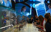 Visitors test smartphones during the Mobile World Congress in Barcelona on February 23 during the first day of the world's biggest mobile fair that...