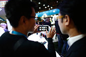 Visitors test the screen of a Nokia Lumia 735 smartphone in the Microsoft Corp pavilion at the Mobile World Congress in Barcelona Spain on Wednesday...