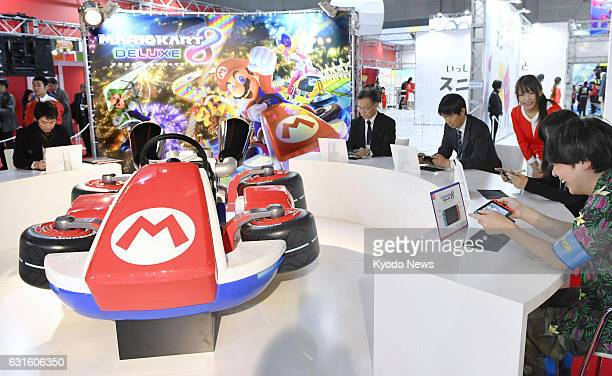 Visitors to a Nintendo Co event at Tokyo Big Sight play the Mario Kart video game on the company's new Switch game console on Jan 13 2017 Nintendo...