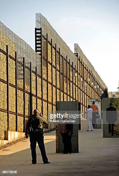 Visitors to Apartheid Museum get their pictures taken at the entrance of the museum on June 13 2009 in Johannesburg South Africa