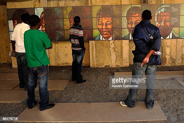 Visitors to Apartheid Museum look at a display on June 13 2009 in Johannesburg South Africa