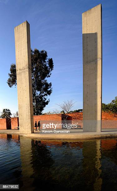 Visitors to Apartheid Museum walk apst the entrance of the museum on June 13 2009 in Johannesburg South Africa