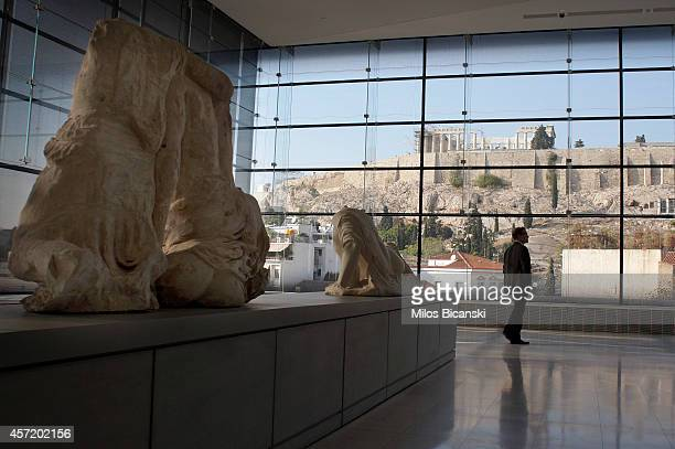 Visitors to Athens' Acropolis Museum look at the frieze of the Temple of Parthenon on October 14 2014 in Athens Greece Lawyers Geoffrey Robertson and...