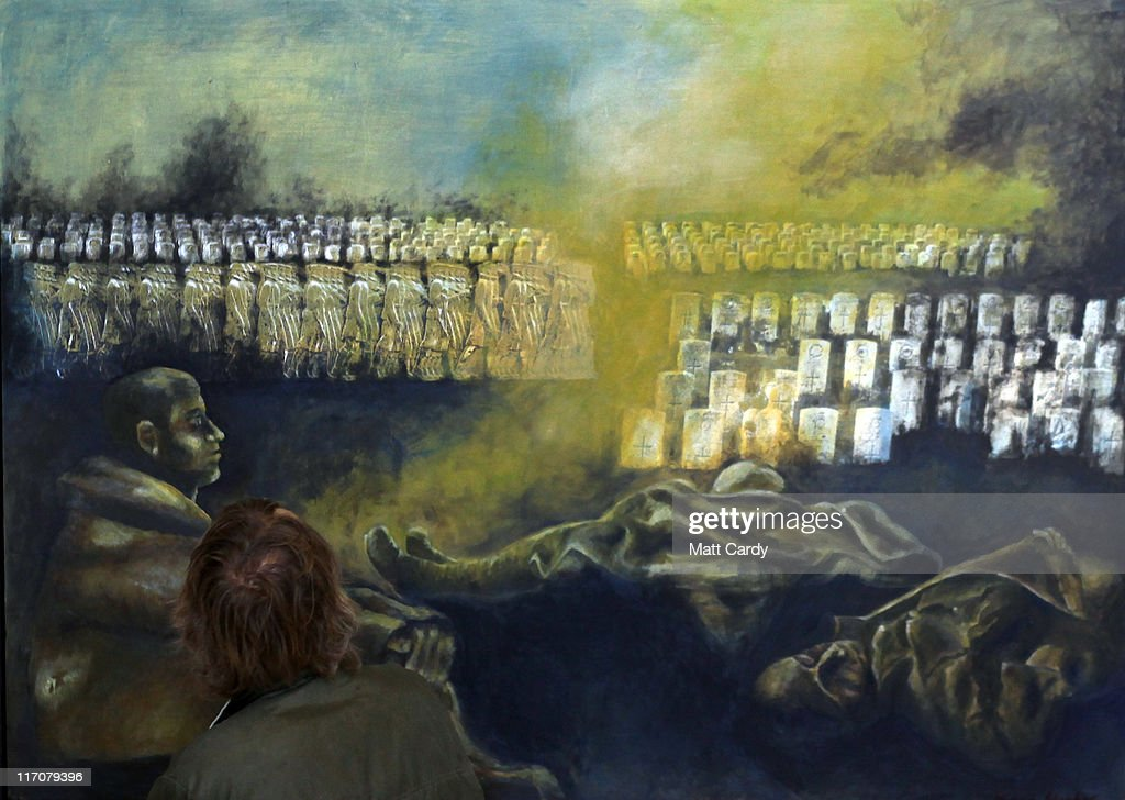 A visitors to Exeter Castle looks at the painting 'Blood Sacrifice' by Diane Hughes on June 21, 2011 in Exeter, England. The paintings are among artworks produced by former and current servicemen and women currently being exhibited at Exeter Castle. The free exhibition, Entrance to War Art, aims to foster understanding between Post Traumatic Stress Disorder (PTSD) sufferers and the wider community and runs until Sunday.