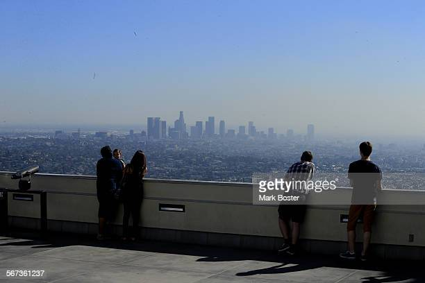 PARK CA OCTOBER 24 2014 Visitors to Griffith park take in a smoggy LA Basin Emissions from cars trucks ships power plants and industrial facilities...