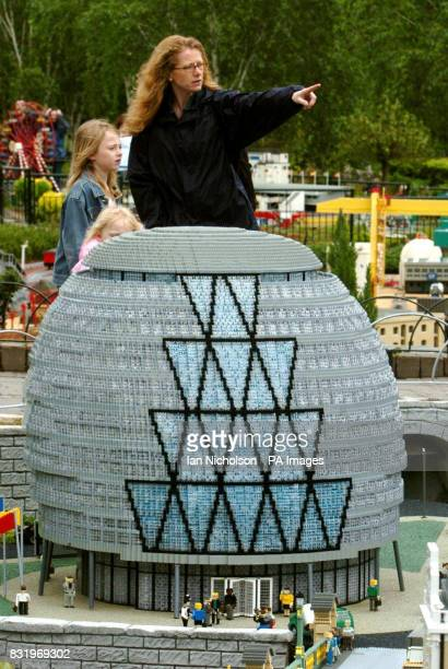 Visitors to Legoland Windsor stand by a model of City Hall after the launch of a new Miniland London exhibit