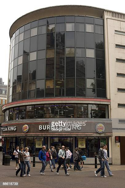 Visitors to Leiscester Square pass a Burger King fast food restaurant as seen in this 2009 London United Kingdom afternoon cityscape
