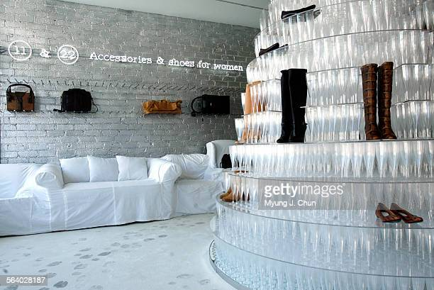 Visitors to Martin Margiela's new boutique in Beverly Hills are greeted by a champagne pyramid made of 6200 glasses The white one–piece cover couches...