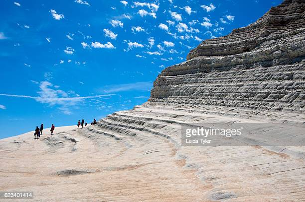 TURCHI REALMONTE SICILY ITALY Visitors to Scala dei Turchi or Stairs of the Turks at Realmonte southern Sicily Italy The Scala is formed by marl a...