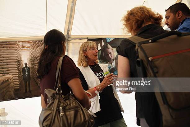 Visitors to 'Starved for Attention' a free interactive exhibit by Doctors Without Borders/Medecins Sans Frontieres in Union Square speak with an MSF...