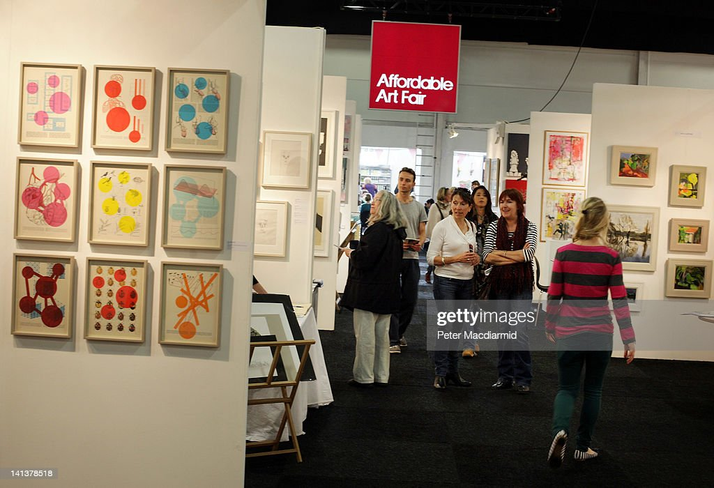 Visitors to The Affordable Art Fair look at paintings on March 15, 2012 in London, England. 120 galleries are displaying works costing from £40 - £4000. Photography, paintings, prints and sculptures are on sale from 15-18th March 2012.