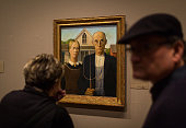 Visitors to the Art Institute of Chicago view the painting 'American Gothic' by Grant Wood January 15 2014 in Chicago Illinois