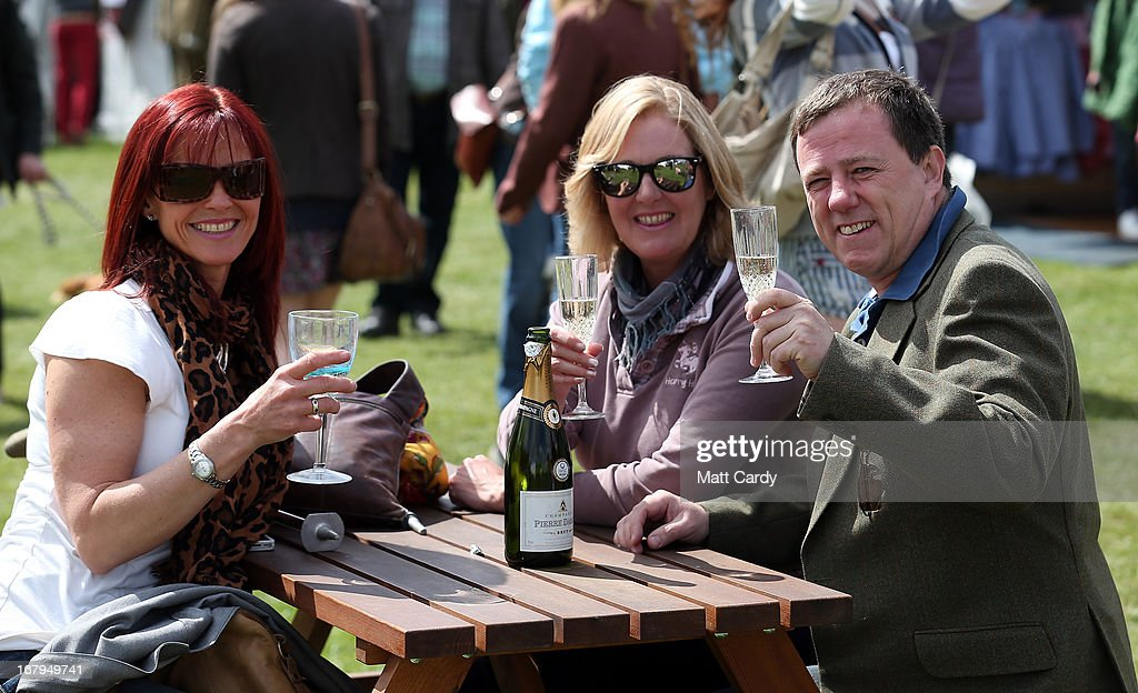 Visitors to the Badminton Horse Trials enjoy a glass of wine on the first full day of the Mitsubishi sponsored event on May 3, 2013 in Badminton, Gloucestershire. The event - which runs until Monday and is held on the Duke of Beaufort's estate, is now in its 22nd year but was cancelled last year due to flooding. It is widely seen by many as one of the highlights in the equestrian eventing calendar.